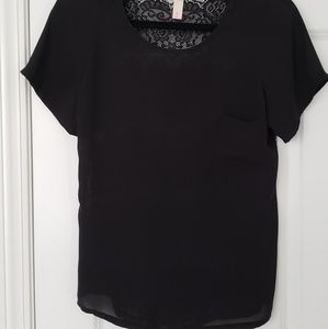 Sheer, lightweight black top with a lacy back